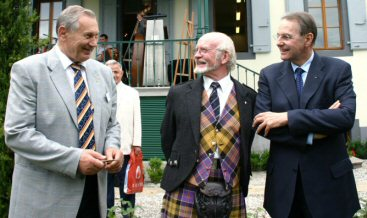 William Baxter, President of FILC sharing a joke with triple Olympic Champion Alexander Medved and Jacques Rogge President of The Olympic Commision